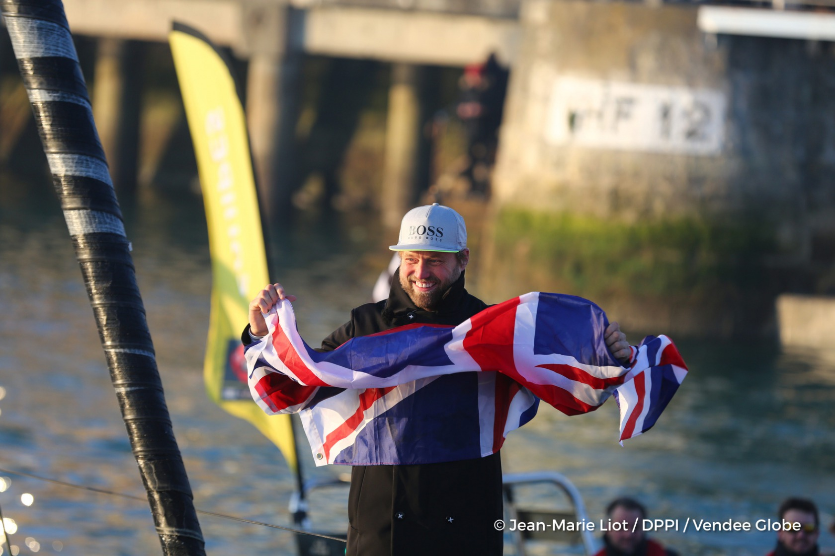 Finish arrival of Alex Thomson (GBR), skipper Hugo Boss, 2nd place of the sailing circumnavigation solo race Vendee Globe, with Union Jack's flag, in Les Sables d'Olonne, France, on January 20th, 2017 - Photo Jean-Marie Liot / DPPI / Vendee Globe