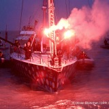 Flares in the channel during Finish arrival of Eric Bellion (FRA), skipper Comme Un Seul Homme, 9th of the sailing circumnavigation solo race Vendee Globe, in Les Sables d'Olonne, France, on February 13th, 2017 - Photo Olivier Blanchet / DPPI / Vendee GlobeArrivée de Eric Bellion (FRA), skipper Comme Un Seul Homme, 9ème du Vendee Globe, aux Sables d'Olonne, France, le 13 Février 2017 - Photo Oli