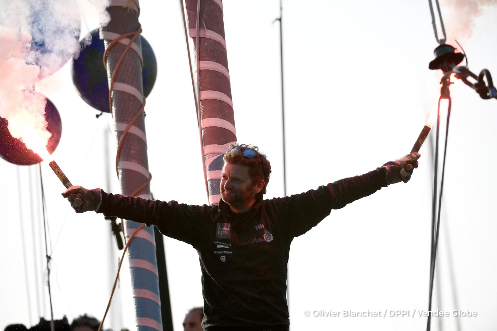 Ambiance channel with flares during Finish arrival of Arnaud Boissieres (FRA), skipper La Mie Caline, 10th of the sailing circumnavigation solo race Vendee Globe, in Les Sables d'Olonne, France, on February 17th, 2017 - Photo Olivier Blanchet / DPPI / Vendee Globe