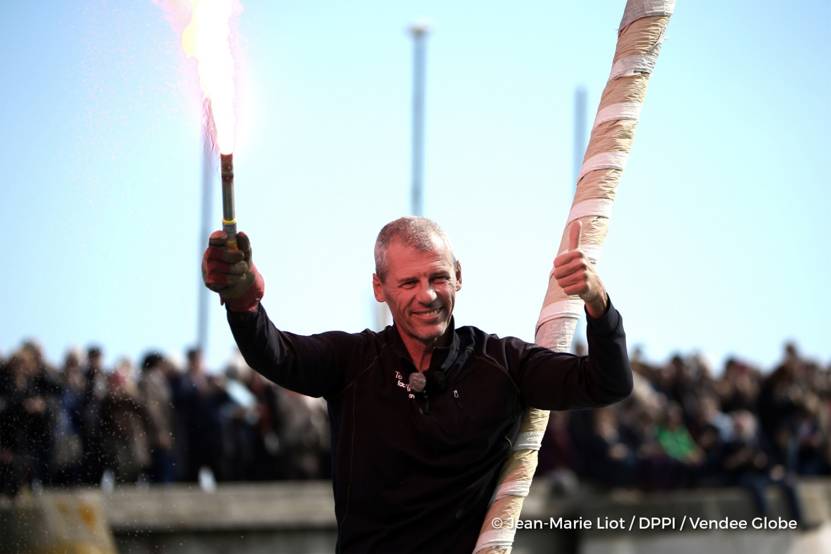 Celebration with flares in the channel during finish arrival of Sebastien Destremau (FRA), skipper Technofirst Face Ocean,18th of the sailing circumnavigation solo race Vendee Globe, in Les Sables d'Olonne, France, on March 11th, 2017 - Photo Jean-Marie Liot / DPPI / Vendee GlobeArrivée de Sebastien Destremau (FRA), skipper Technofirst Face Ocean, 18ème du Vendee Globe, aux Sables d'Olonne, Fran