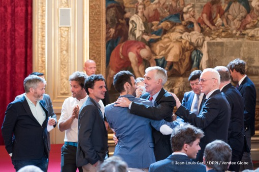Alan Roura (SUI), skipper La Fabrique, and Rich Wilson (USA), skipper Great American IV, hug during the ceremony to honour sailing competitors, including Vendee Globe skippers, by French president Francois Hollande, at the Elysee presidential palace in Paris on April 20th, 2017 - Photo Jean-Louis Carli / DPPI