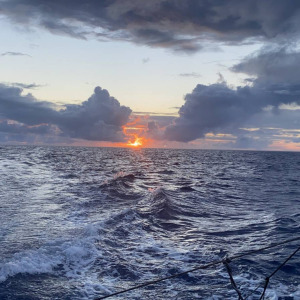 Rare moment in the race: Armel Tripon was able to enjoy a sunset from the deck of his boat on an almost flat sea