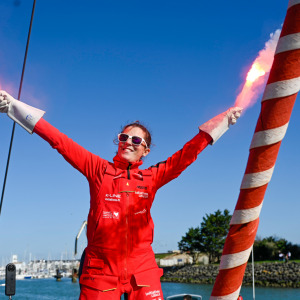 Sam celebrating with flares during her ascent of the channel